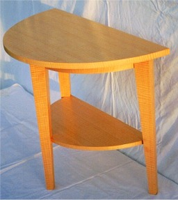 custom demilune end table in anigre by RJ Fine Woodworking