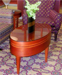 custom oval hat box coffee Table by RJ Fine Woodworking