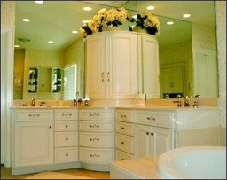 custom made This design incorporates a corner curved drawer fronts and counter top medicine cabinet.